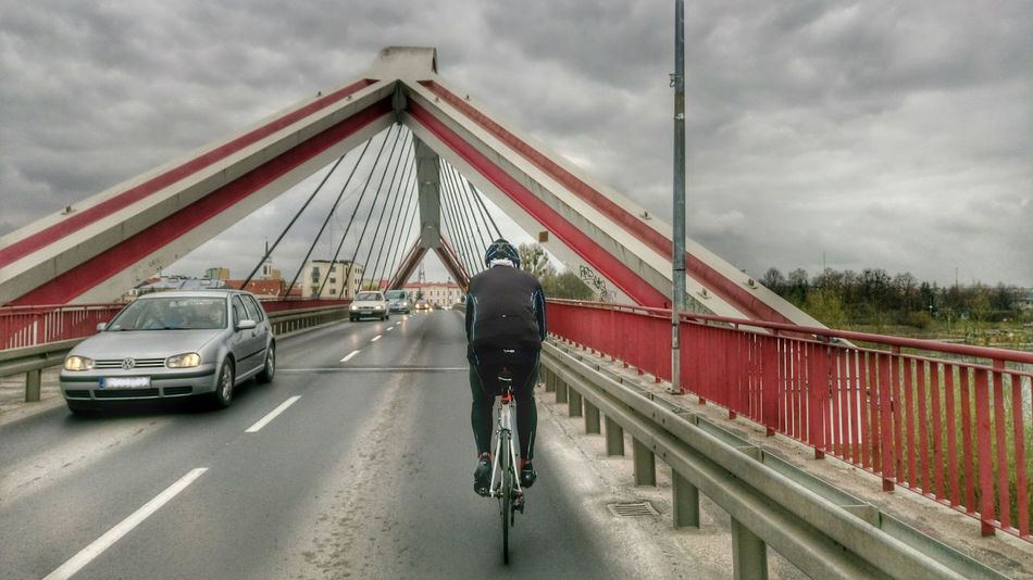 Bike Bridge - Man Made Structure Cloud - Sky Cycling Full Length Lifestyles Men Railing Real People Rear View Smartphone Photography Smartphonephotography The Way Forward Transportation