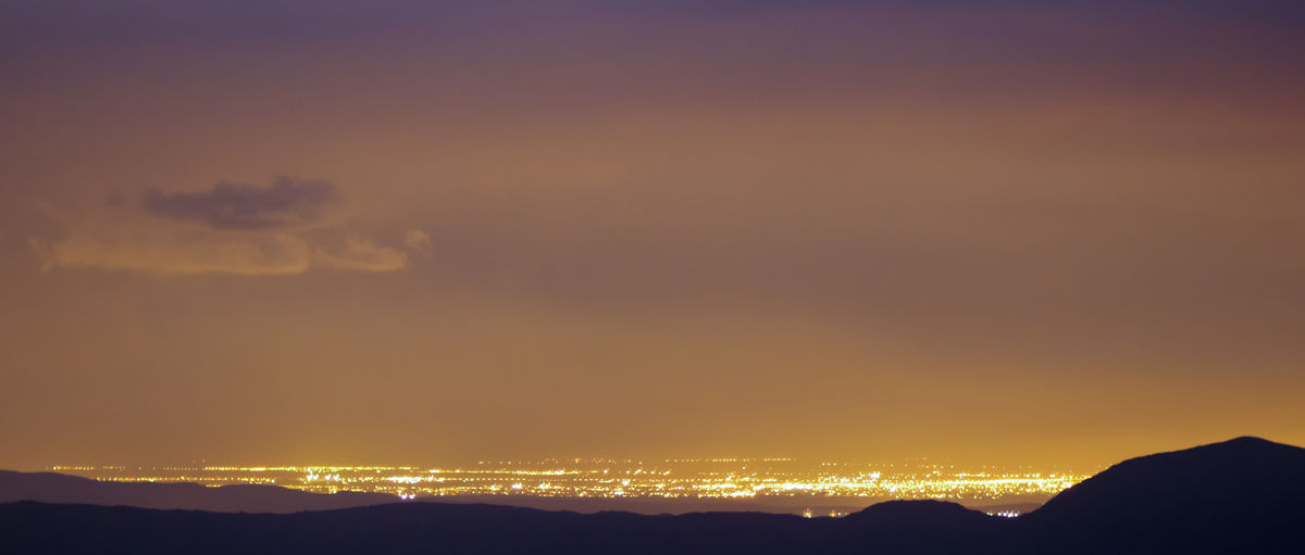 City Lights At Night Night Lights Citylights Idyllic Landscape Landscape_photography Majestic Mountain Range Nature Night Nigth Ligths No People Orange Color Outdoors Silhouette Sky Tranquility