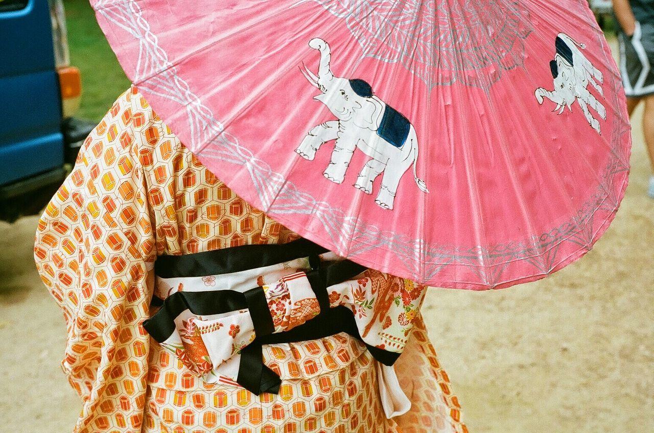 Close-up of person under umbrella