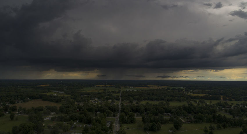 A summer storm passes over Carterville, Illinois in a aerial photograph. Drone  Aerial Aerial View Architecture Beauty In Nature Cloud - Sky Day Dramatic Sky Dronephotography Environment Landscape Nature No People Ominous Outdoors Overcast Plant Power In Nature Scenics - Nature Sky Storm Storm Cloud Thunderstorm Tranquil Scene Tranquility