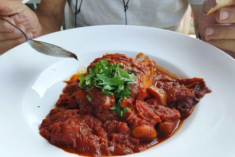 Close-up of man preparing food in plate