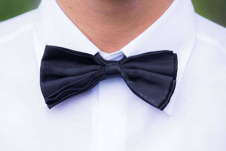 Close-up of man wearing bow tie