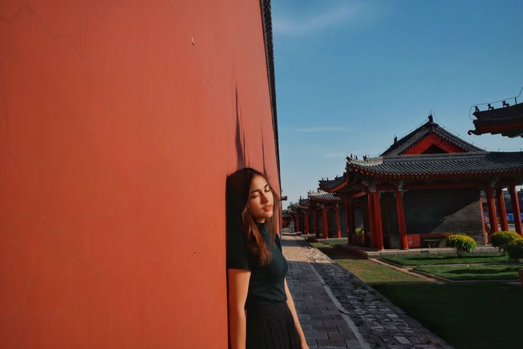 The Portraitist - 2017 EyeEm Awards Architecture Built Structure One Person Young Adult Young Women Real People Building Exterior Lifestyles Leisure Activity Outdoors Day Sky People