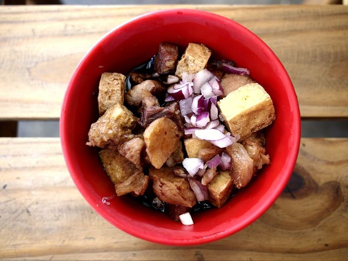 bowl of fried pork and tofu known to Filipinos as Tokwa't (tofu) Baboy (pork). Fried Tofu Fried Pork And Tofu Food Asian Foods Filipino Food Tokwa Tokwatbaboy Pork Baboy Tofu Fried Tofu Healthy Eating Healthy Food Breakfast Lunch Dinner Meal Dish Side Dish Bowl Red Table Fruit Close-up Food And Drink