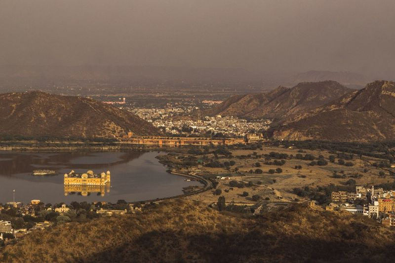 The desertscape Aravalli Rajasthan Jalmahal Jaipur Water Nature Mountain Environment No People Scenics - Nature Landscape City Building Exterior Tranquility Illuminated Tranquil Scene High Angle View Architecture Beauty In Nature Sky Built Structure Land Outdoors