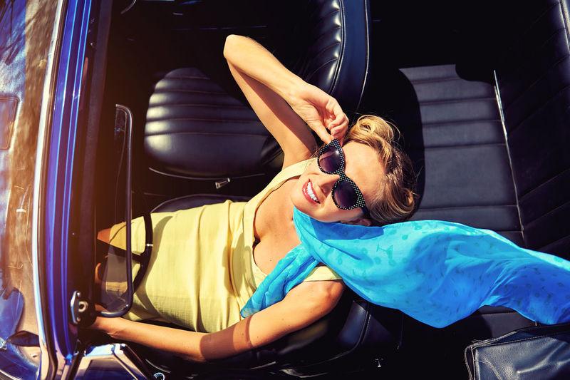 Elegant Woman In Convertible Car