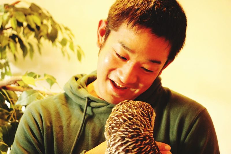 Smiling Young Man With Bird