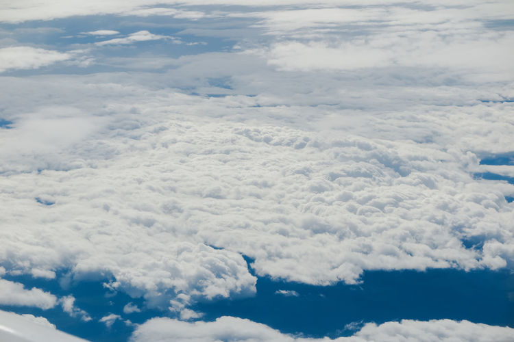 clear blue sky background with white clouds from above Cloud - Sky Beauty In Nature Scenics - Nature Tranquility Sky Tranquil Scene Cloudscape No People Idyllic Nature Day White Color Outdoors Backgrounds Fluffy Meteorology Softness Low Angle View Full Frame Majestic Aerial View