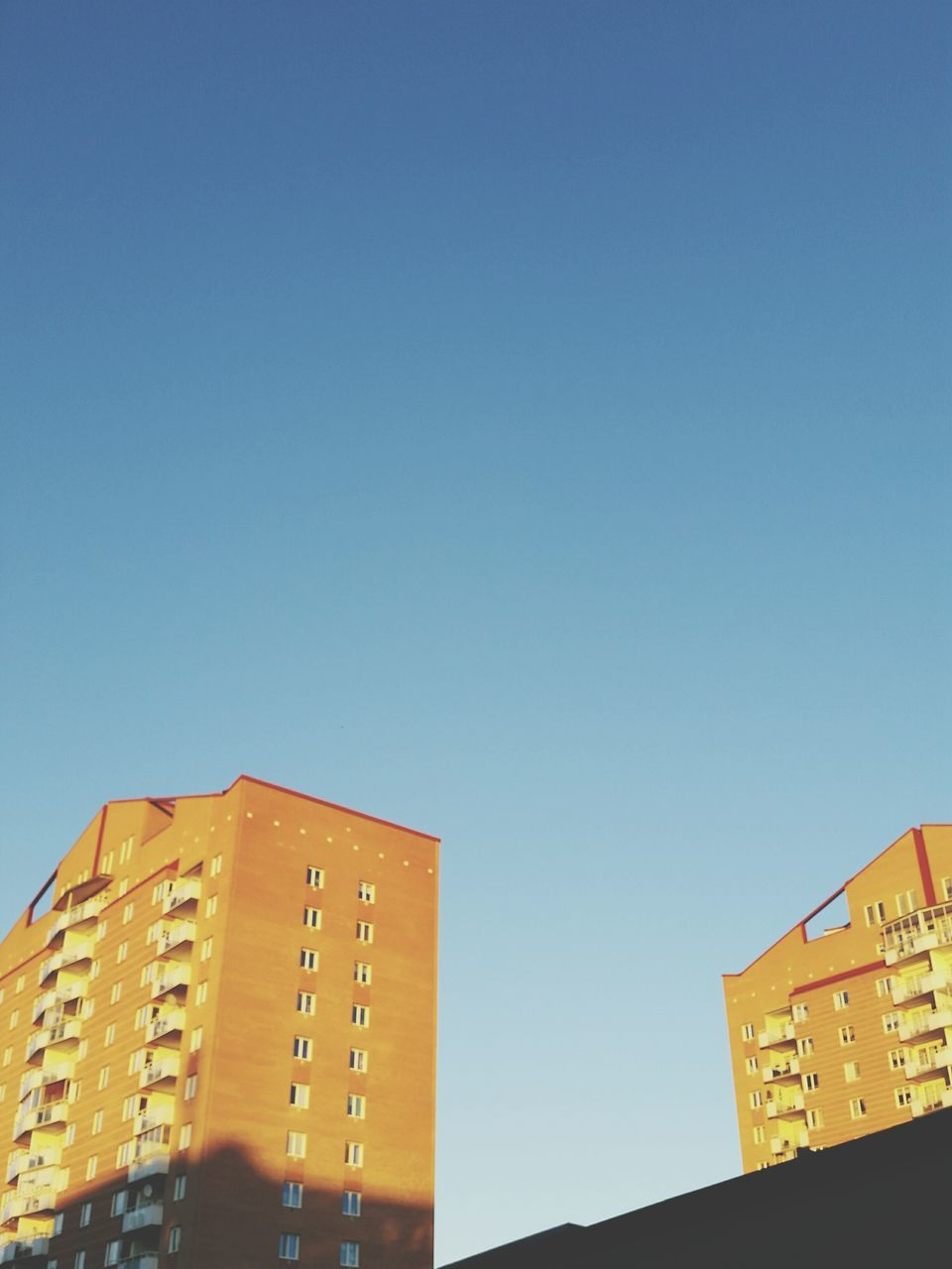 architecture, copy space, clear sky, building exterior, architectural style, blue, city, no people, modern, outdoors, day