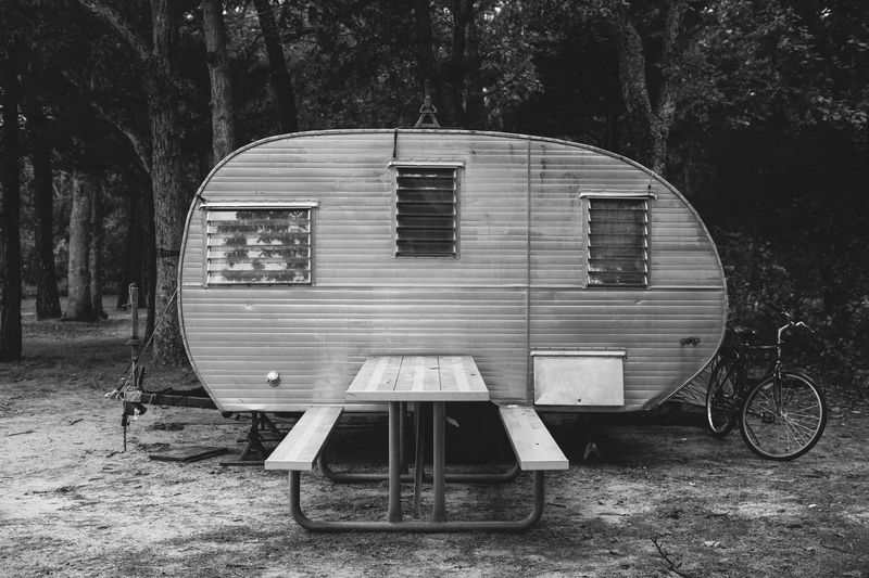 Vintage caravan Camper Caravan Rural Scene Gypsy Van Life NOMAD Traveling Retirement Vintage Country Living Rural Life Camping Vacations Summer Seat No People Tree Nature Day Field Plant Outdoors Park - Man Made Space