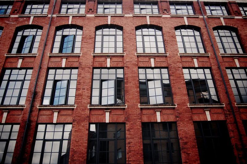 Full frame shot of building with reflection on window glass