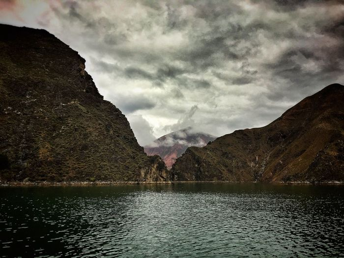 Mountain Water Tranquil Scene Scenics Tranquility Waterfront Mountain Range Lake Beauty In Nature Sky Cloud - Sky Nature Cloudy Remote Cloud Non-urban Scene Day Outdoors Majestic Countryside