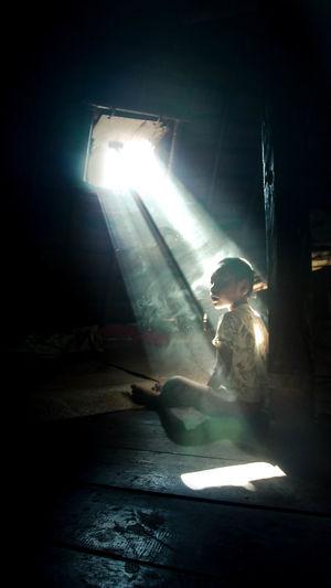 Man holding illuminated light in dark room