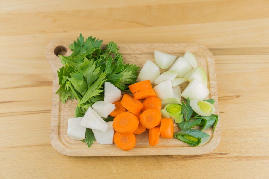 Garlic Herbs Leek Carrots Celery Close-up Cutting Board Day Food Food And Drink Freshness Healthy Eating High Angle View Indoors  Mirepoix No People Onions Vegetable Wooden Background