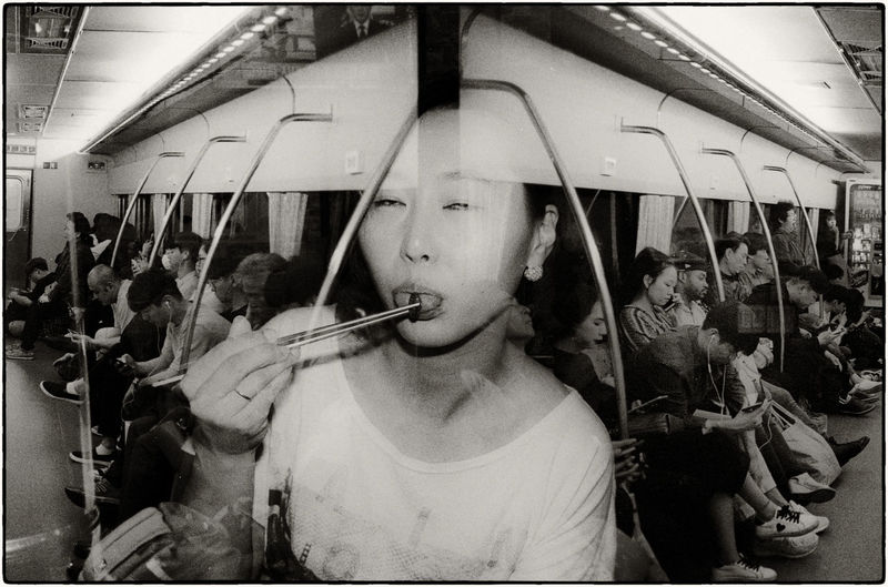 While the awards called for heavy photoshop, this photo is in fact, a triple exposure made on Ilford HP5 film. The back two photos represent either side of a Seoul train and the middle photo is a Korean girl on a night out eating silk worm larvae. Beondegi is a traditional drinking food in Korea and is usually packed into small dishes or paper cups. Double Exposure Ilford Film Korea Seoul The Creative - 2018 EyeEm Awards The Street Photographer - 2018 EyeEm Awards Buyfilmnotmegapixels Filmisnotdead Leica Camera