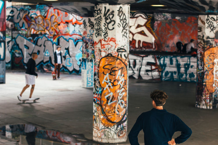 Young men at graffiti skateboard park