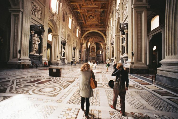Tourists walking in large interior