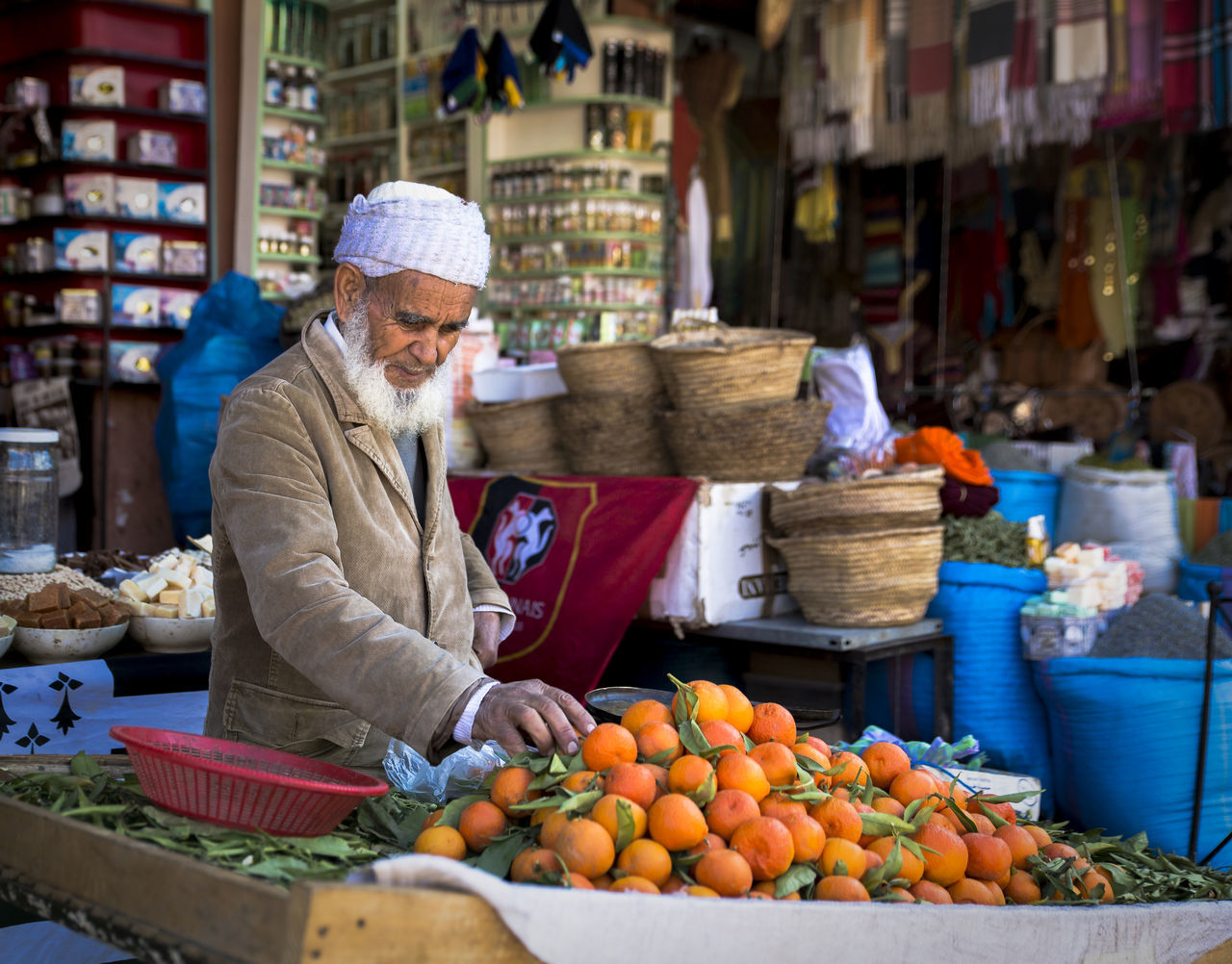 fruit, freshness, market, one person, food, food and drink, healthy eating, choice, market stall, retail, real people, outdoors, senior adult, vegetable, day, one man only, healthy lifestyle, men, adult, adults only, people