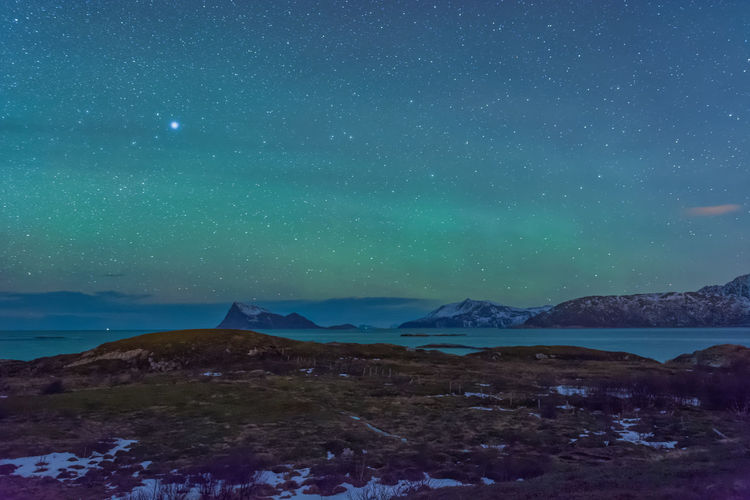 Fjords in Norway with weak Northern Lights Astronomy Astrophotography Beauty In Nature Dark Fjords Landscapes Mountains Nature Night Night Photography No People Non-urban Scene Northern Lights Norway Outdoors Scenics Sky Snow Stars Tranquil Scene Water Aurora Borealis Overnight Success