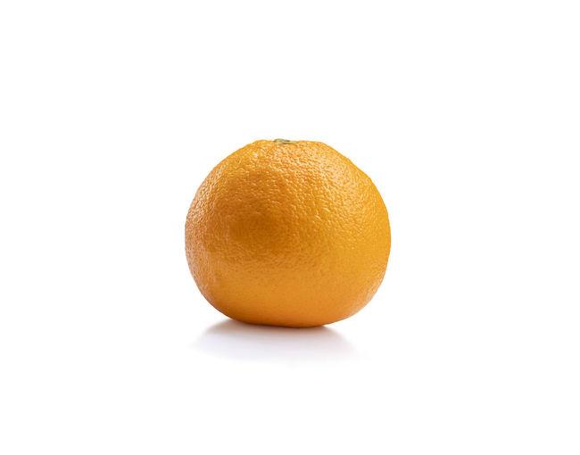 Close-up of orange fruit against white background