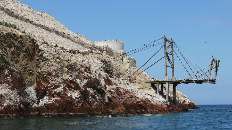A pier that looks like a broken bridge at Isla Ballasteras, Ica, Peru. Pier Island Peru