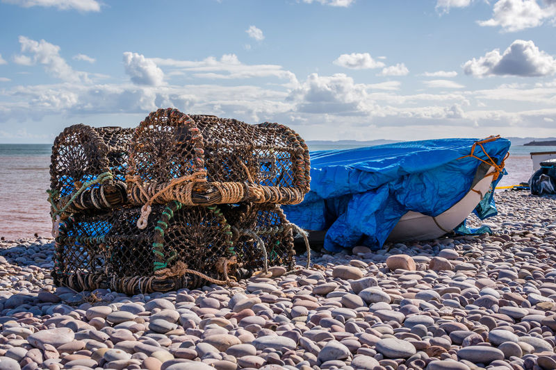 Crab Beach Beauty In Nature Blue Cloud - Sky Crab Nets Day Fishing Industry Horizon Over Water Land Nature Nautical Vessel Outdoors Pebble Rock Rock - Object Scenics - Nature Sea Sky Solid Sunlight Transportation Water