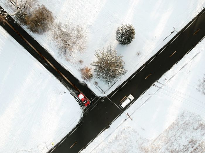 High angle view of car window on snow covered landscape