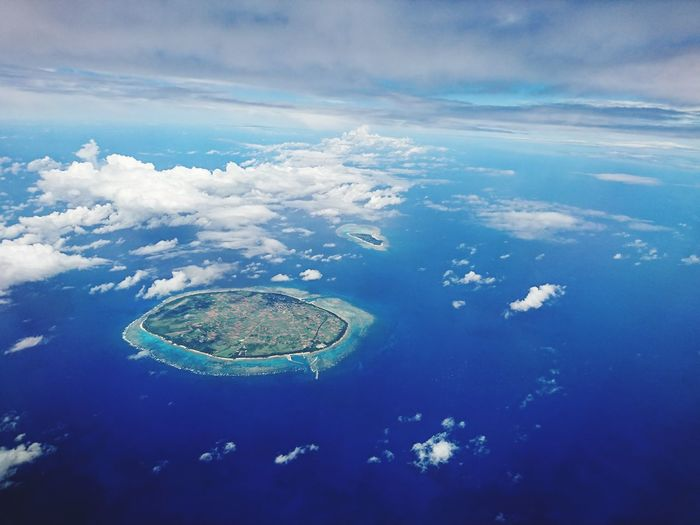 Aerial view of island and sea against sky