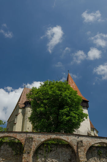 Built Structure Church Clouds Cloudy Historic History Monastery Outdoors Religion Sky Spirituality Tower Tree