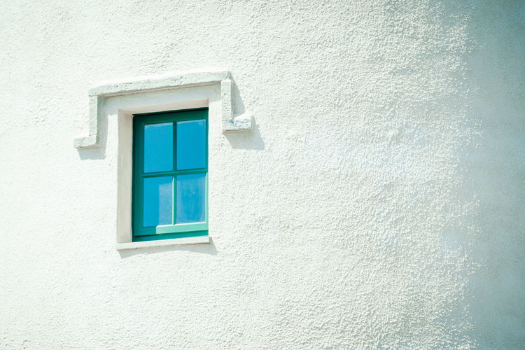 Closed window of white building