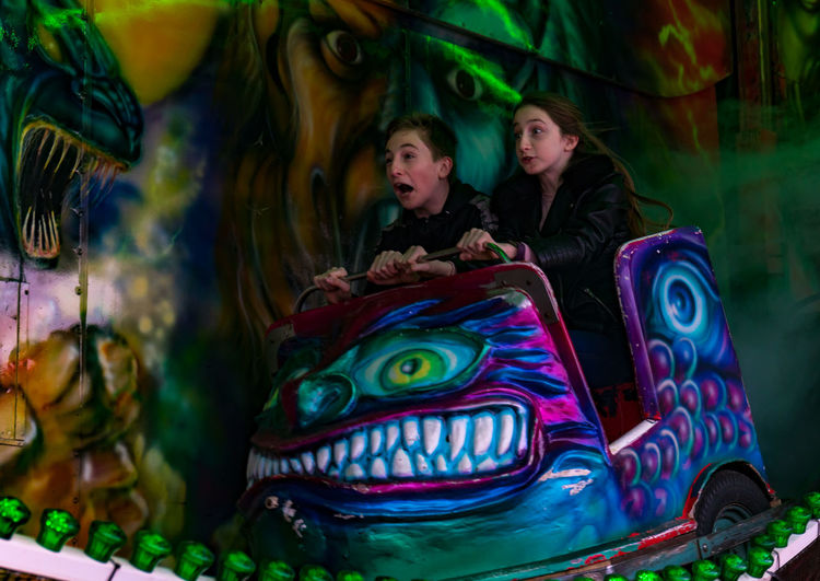 All the fun of the fair - well of a little unexpected drop Funfair Ghost Train Siblings Amusement Park Child Childhood Enjoyment Funfair Ride People Shock Thrill Two People