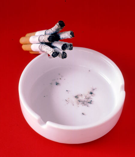 ashtray with a bunch of three cigarettes Bad Bunch Burn Burning Cigarettes Close-up Danger Deseas Habit Hashtray No People Red Red Background Still Life Tobacco Barn Tobacconist Unhealthy Lifestyle Vice