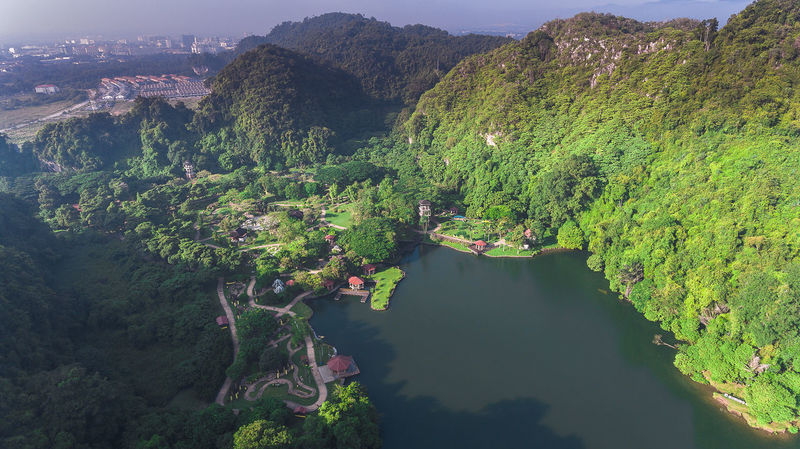 Aerial view at Gunung Lang, a famous tourism and recreational place to visit at Ipoh, Perak Malaysia Hill Mountain Lake Water Boat Perak Malaysia Malaysia Truly Asia TourismPerak Drone  Trees Recreational  Holiday Tourism Tree Mountain Water Rural Scene Agriculture Lake Forest Sky Landscape Green Color Aerial View Valley