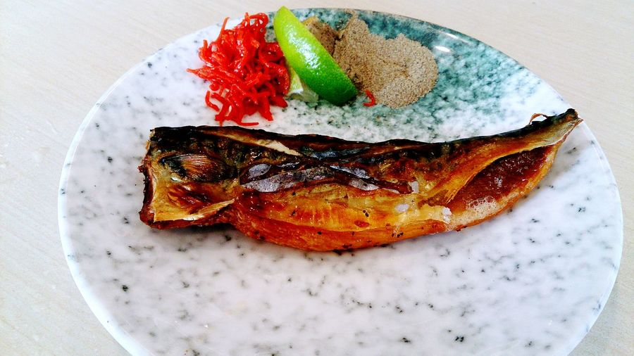 Close-Up Of Fired Fish Served In Plate