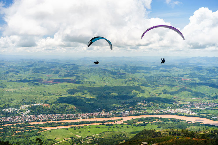 Paraglider is flying in Brazil, aerial view. Brazil Adventure Beauty In Nature Cloud - Sky Day Environment Exhilaration Extreme Sports Flying Freedom Governadorvaladares Joy Landscape Leisure Activity Mid-air Nature Outdoors Parachute Paragliding Scenics - Nature Sky Sport Transportation Unrecognizable Person Valadares