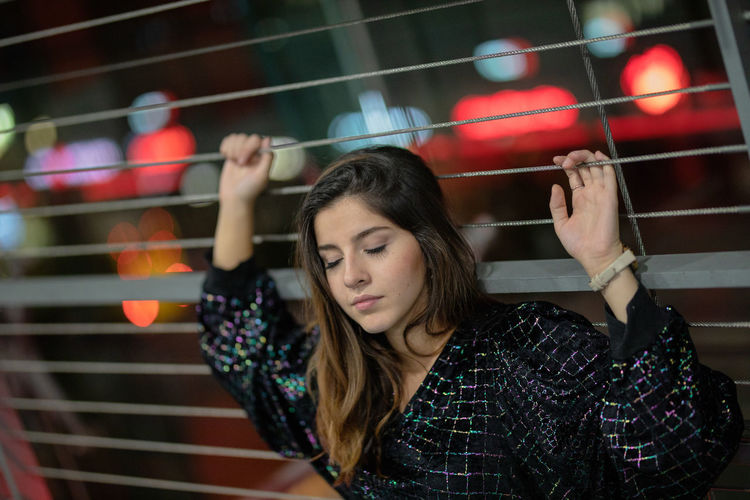 Arms Raised Beautiful Woman Brown Hair Casual Clothing Focus On Foreground Front View Hair Hairstyle Headshot Human Arm Leisure Activity Lifestyles Long Hair Looking One Person Portrait Real People Sport Teenager Women Young Adult Young Women