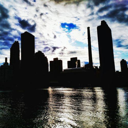 Menacinh Manhattan New York City Skyline Sky Clouds Dramatic Sky Reflection NYC Sunset Skyscrapers