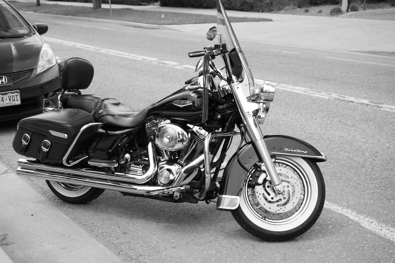 transportation, road, street, land vehicle, mode of transport, car, motorcycle, day, outdoors, no people