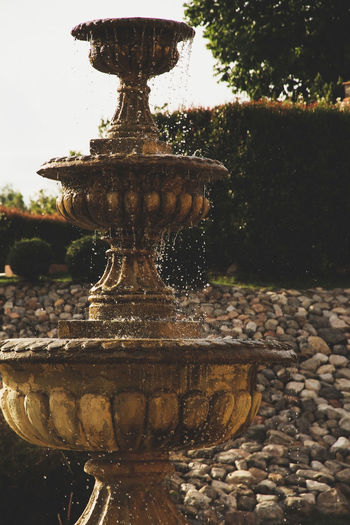 Close-up of old stone fountain decoration in the garden Decor Close-up Day Decoration Decorative Decorative Art Drinking Fountain Exterior Design Fountain Motion Nature No People Outdoors Sculpture Splashing Spraying Statue Water