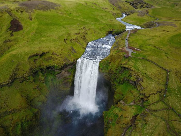 Another view of Skogafoss, Iceland Aerial Waterfalls Landscape Travel Traveling Landscape_Collection Landscapes Beauty In Nature Nature Nature_collection Naturelovers Nature Photography EyeEm Nature Lover Eye4photography  EyeEm Best Shots DJI Mavic Pro Drone  Dji Dronephotography Droneshot Aerial View Iceland Skogafoss EyeEm Gallery Water Motion High Angle View Waterfall Countryside Idyllic
