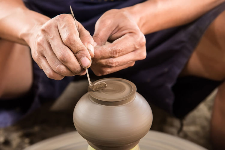 Close-Up Of A Person At Pottery Wheel