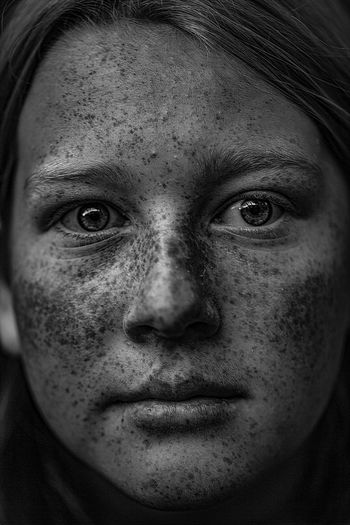 Close-up portrait of teenage girl with freckles