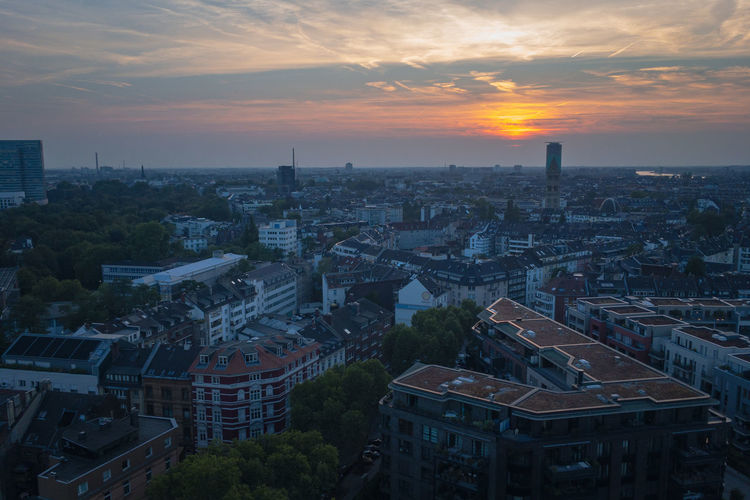 High angle view of buildings in dusseldorf, germany against sky during sunset