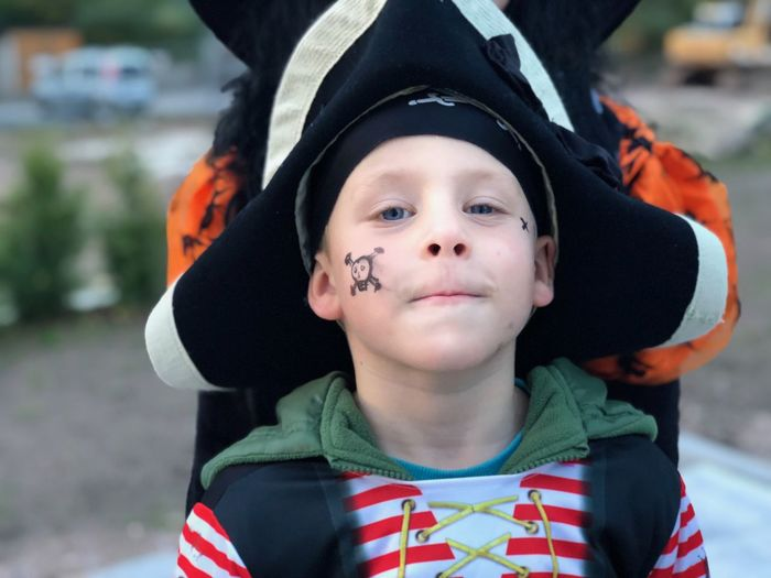 Portrait of cute boy wearing pirate costume