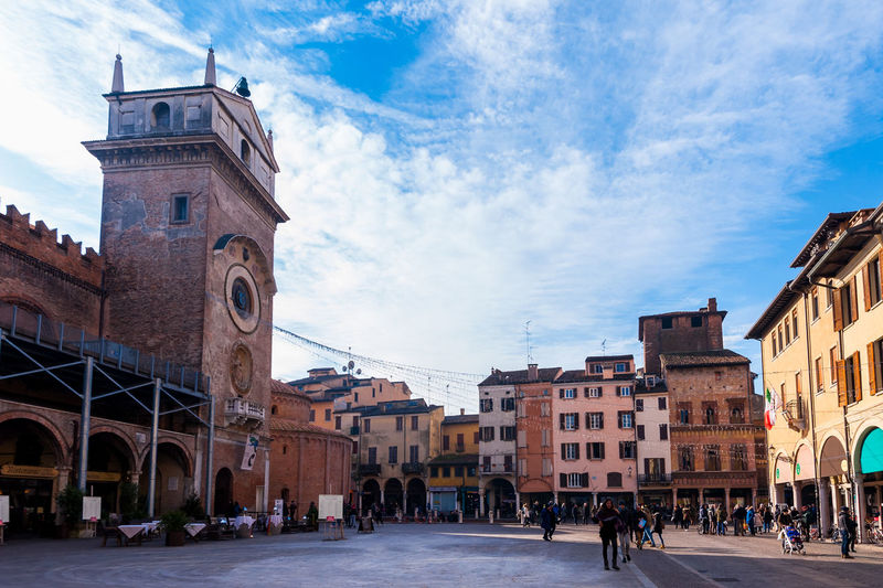 Mantova, Italy - January 5 2018 : View of Piazza delle Erbe, Mantua, Lombardy, Italy. Architecture Built Structure Building Exterior Building Sky Cloud - Sky City Religion Place Of Worship Nature Spirituality Belief Tower Day Town Street Group Of People History Outdoors Mantua Italy Travel Square Herbs