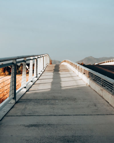 Surface level of bridge against clear sky