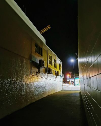 Moonlight in the alley and crane EyeEmNewHere EyeEm Best Shots Illuminated Architecture Built Structure Residential Structure Street Light Urban Scene