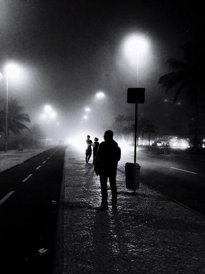 People walking on road at night