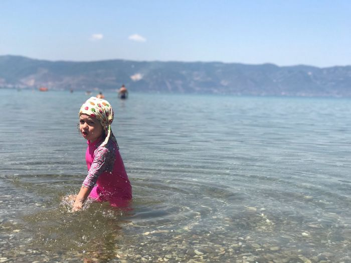 Ohrid Lake Water Sea Day Childhood One Person Outdoors Leisure Activity Real People Nature Vacations Beach Elementary Age Girls Lifestyles Happiness Smiling Sky Beauty In Nature People