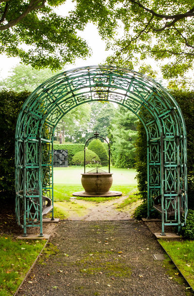 Arch Architectural Feature Architecture Building Exterior Built Structure Ceiling Circle Day Famous Place Garden Grass Hanging Kykuit Metal Metallic No People Sleepy Hollow Trees Water Wheel